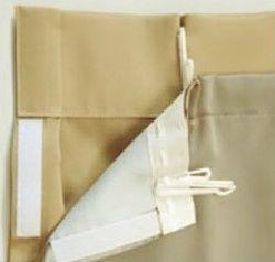 カーテンに遮光裏地をつけた吊り元のイメージ